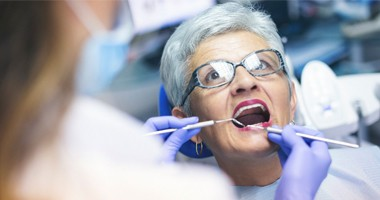 Mature woman having a dental examination.