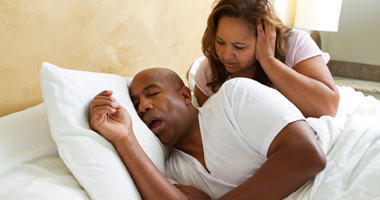 Man keeping partner awake due to snoring.
