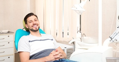 Man in dental hair with brown hair smiling