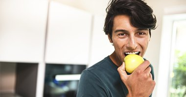 man enjoying an apple