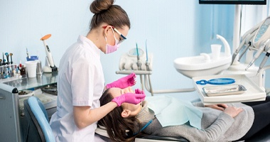 Dental hygienist performing scaling and root planing
