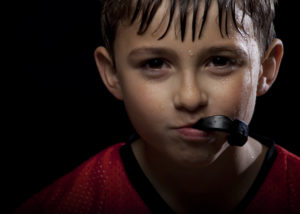 young student athlete with mouthguard