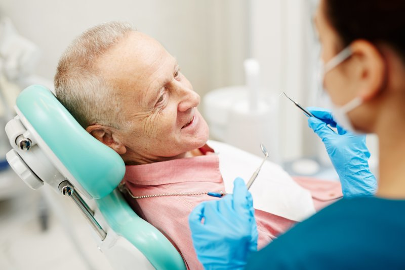 an older man having his teeth checked