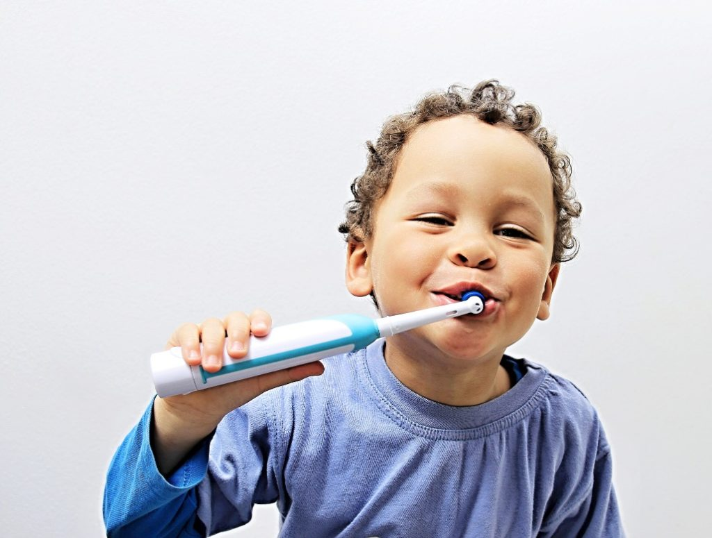 Little boy brushing his teeth with tips from a dentist in Medford