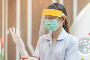 Medford dentist dons PPE to prepare for appointment in COVID-19