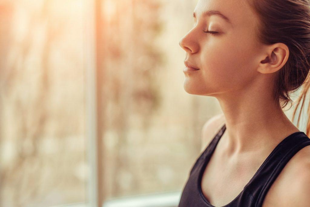 Woman breathing fresh air at safe dentist in Medford