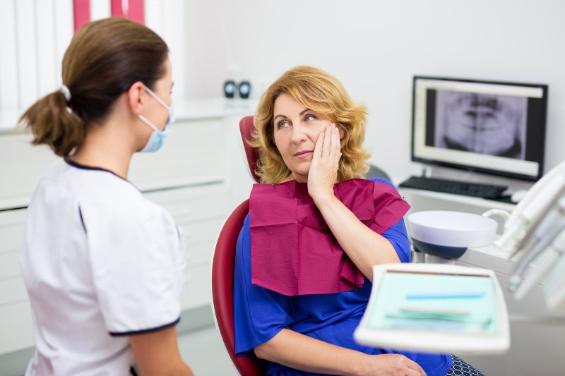 Patient visiting dentist about ill-fitting dentures